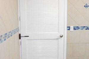 new door to renovated bathroom
