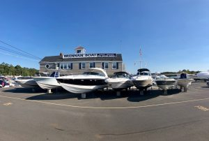 front view of marina store with boats for sale