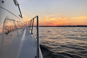 sunset view from bow of brennan boat